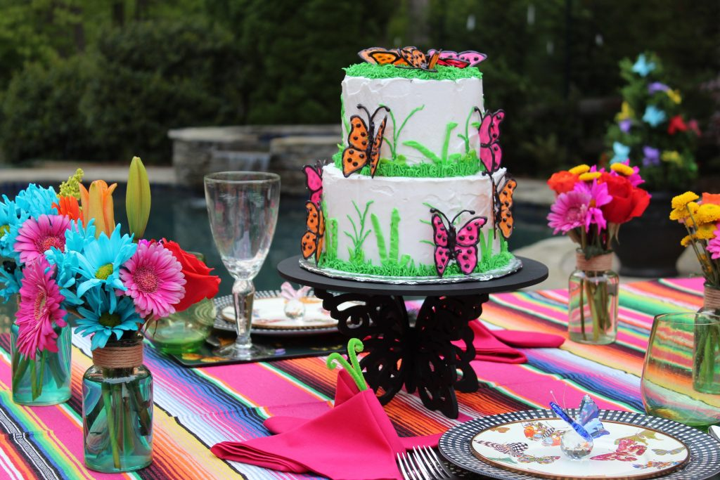 A poolside setting for a  Butterfly Mother's Day Tablescape
