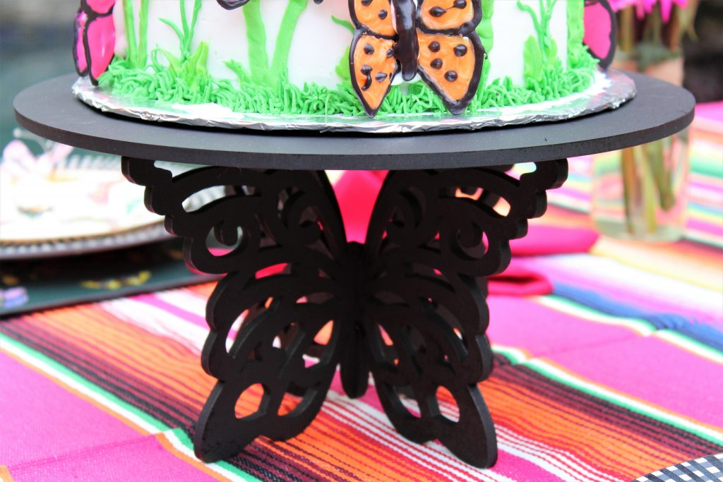 Butterfly cake stand  hold a butterfly cake in a  Butterfly Mother's Day Tablescape