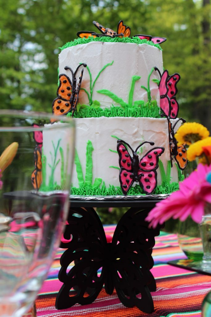 Butterfly Cake serves as the centerpiece on a Butterfly Mother's Day Tablescape