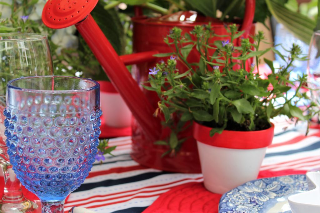 Patriotic tablescape with charming mini red and white pots of blue Lobelia.