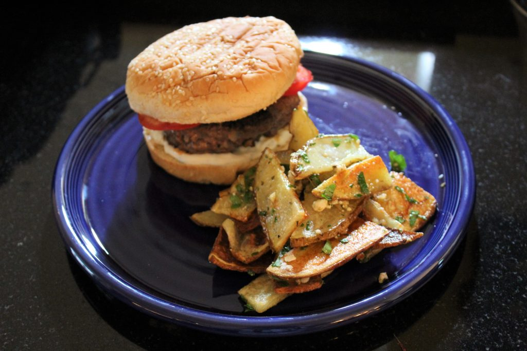 Deliciously spiced lamb burgers and oven fries are part of a Greek-inspired Father's Day Menu.