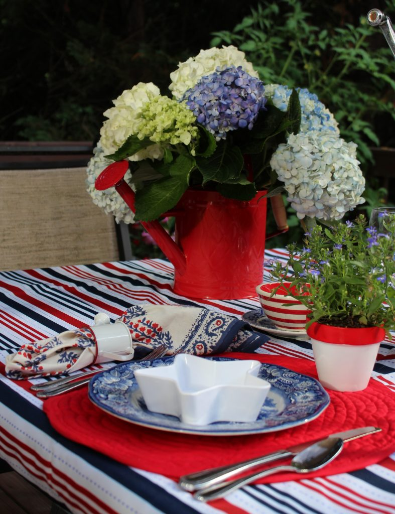 A pretty red, white, and blue  tablescape that packs a patriotic punch.